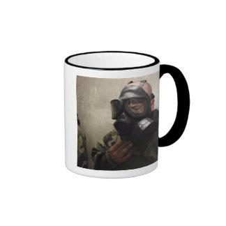 A field radio operator clears CS gas Coffee Mugs
