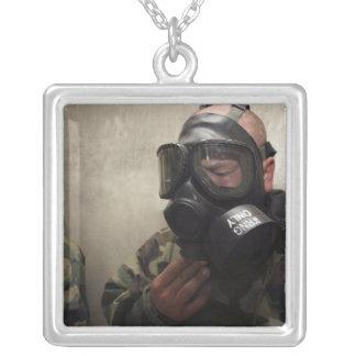 A field radio operator clears CS gas Custom Jewelry