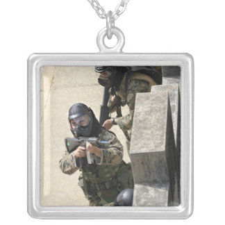 A fire team returns fire from a balcony square pendant necklace