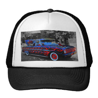 A flaming old car, oon a truckers hat