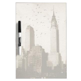 A flock of birds flying dry erase board