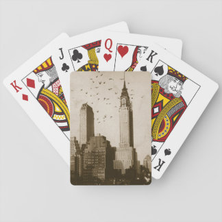 A flock of birds flying playing cards