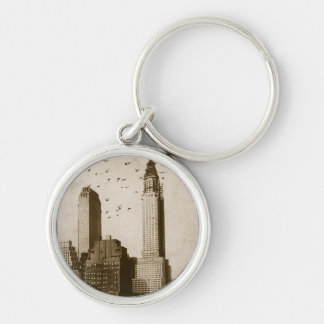 A flock of birds flying Silver-Colored round keychain