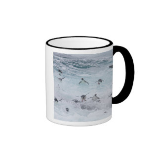 A flock of Rockhopper penguins launch out of the Ringer Coffee Mug