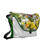 a flowering plant and called pansy messenger bag