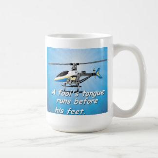A fool tongue runs before his feet. mugs