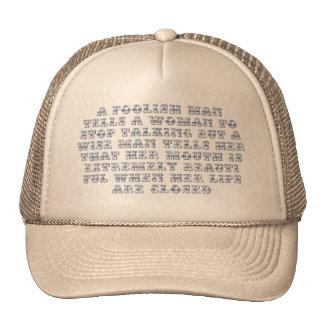 A foolish man tells a woman to stop talking, trucker hat
