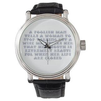 A foolish man tells a woman to stop talking, wristwatches