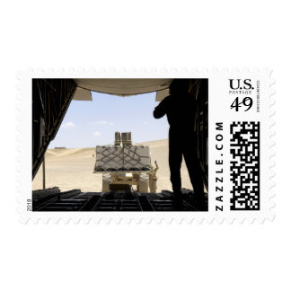 A forklift loads cargo onto a C-130 Hercules Postage Stamp