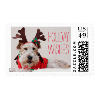 A fox terrier is dressed up for Christmas Postage Stamp