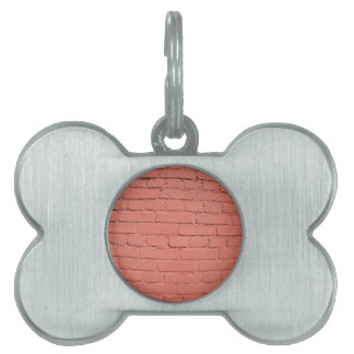 A fragment of a brick wall painted pet name tag