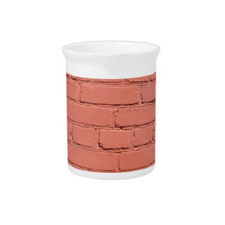 A fragment of a brick wall painted beverage pitcher
