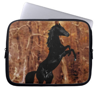 A friesian in winter snow computer sleeve