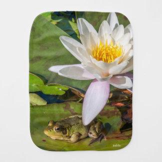 A frog under a flower burp cloth