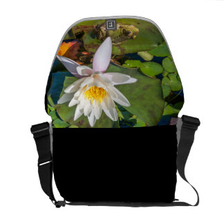 A frog under a flower of water lily courier bag