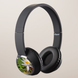 A frog under a flower of water lily headphones