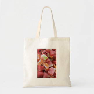 A fruit salad of melons and oranges tote bag