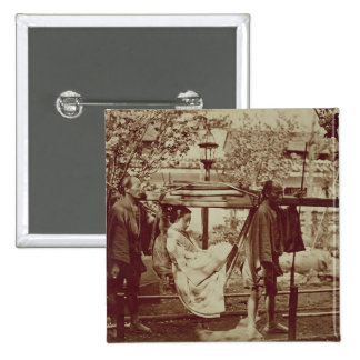 A Geisha being carried in a litter (sepia photo) Button