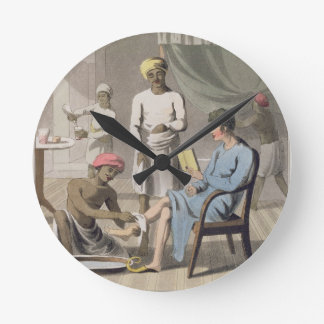 A Gentleman Dressing, attended by his Head Bearer, Round Clock