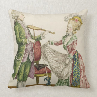 A gentleman playing the violin while a lady dances throw pillows