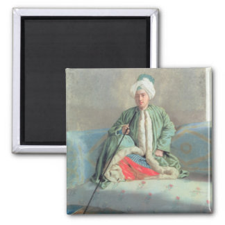 A Gentleman Seated on a Couch Refrigerator Magnet