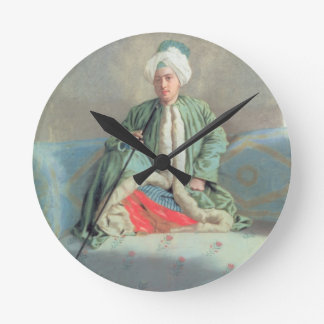 A Gentleman Seated on a Couch Round Clock