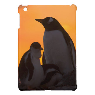 A gentoo penguin adult and chick are silhouetted iPad mini case
