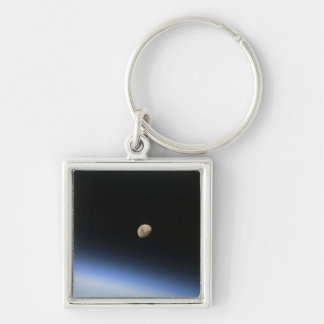 A gibbous moon visible above Earth's atmosphere 2 Keychains