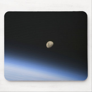 A gibbous moon visible above Earth's atmosphere 2 Mouse Pad