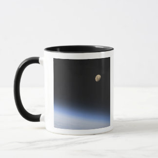 A gibbous moon visible above Earth's atmosphere Mug