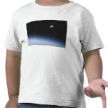 A gibbous moon visible above Earth's atmosphere T Shirts