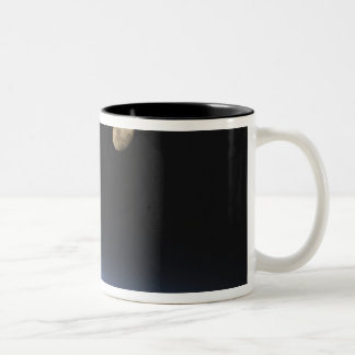 A gibbous moon visible above Earth's atmosphere Two-Tone Coffee Mug