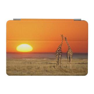 A Giraffe couple walks into the sunset in iPad Mini Cover