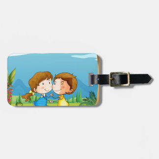 A girl and a boy dancing at the park bag tag