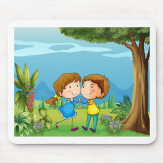 A girl and a boy dancing at the park mouse pad
