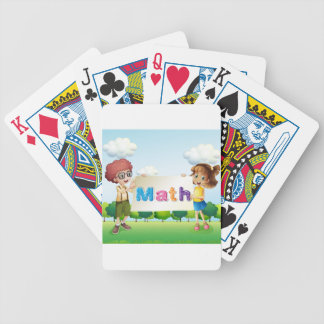 A girl and a boy holding a math signage bicycle playing cards