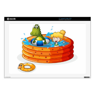 A girl and a crocodile swimming inside the inflata laptop decals