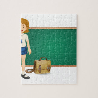 a girl and green board puzzles