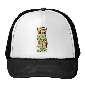 A girl dressed with an angel holds the christmas b mesh hats