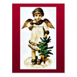 A girl dresses like an angel catching christmas tr post card