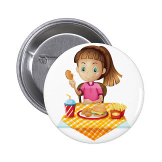 A girl eating at the fastfood store buttons