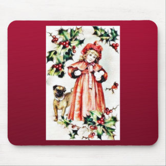 A girl holding ball like thing in hand and a dog l mouse pad