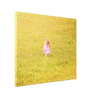 A girl in a garden canvas print