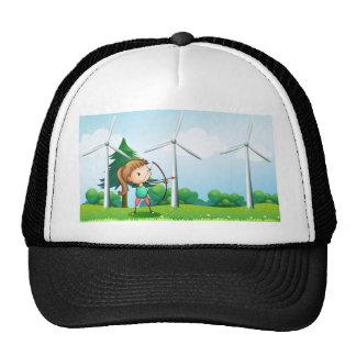 A girl with an archer near the windmills trucker hat