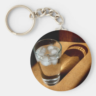 A Glass of Ice water in the sun light. Basic Round Button Keychain