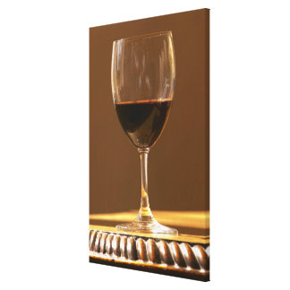 A glass of red Chateau Belgrave in sunlight - Canvas Print