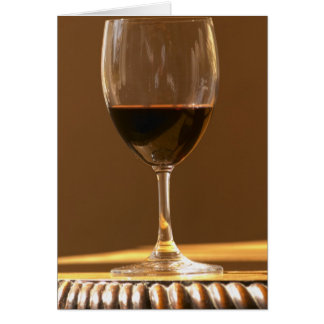 A glass of red Chateau Belgrave in sunlight - Card