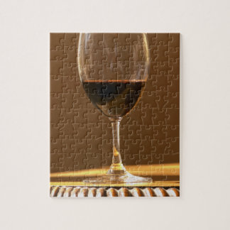 A glass of red Chateau Belgrave in sunlight - Jigsaw Puzzle