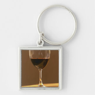 A glass of red Chateau Belgrave in sunlight - Keychain