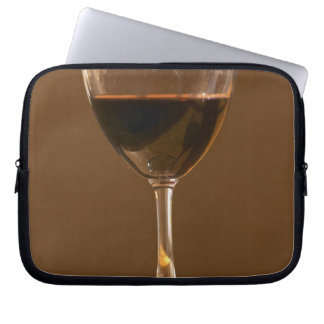 A glass of red Chateau Belgrave in sunlight - Laptop Sleeve